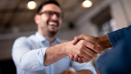 close-up-business-people-shaking-hands